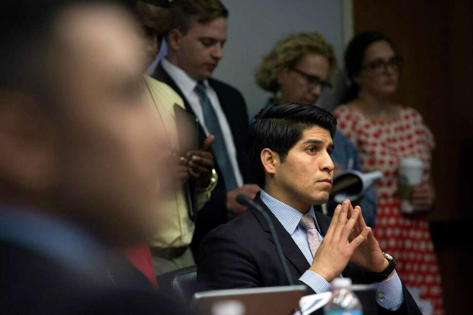 Former District 4 City Councilman Rey Saldaña listens during a meeting. A reader finds it selfish of council members to consider free lifetime parking for themselves once they have termed out of office. Photo: Ray Whitehouse /for The San Antonio Express-News