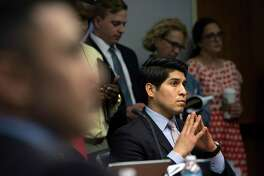 Former District 4 City Councilman Rey Saldaña listens during a meeting. A reader finds it selfish of council members to consider free lifetime parking for themselves once they have termed out of office.