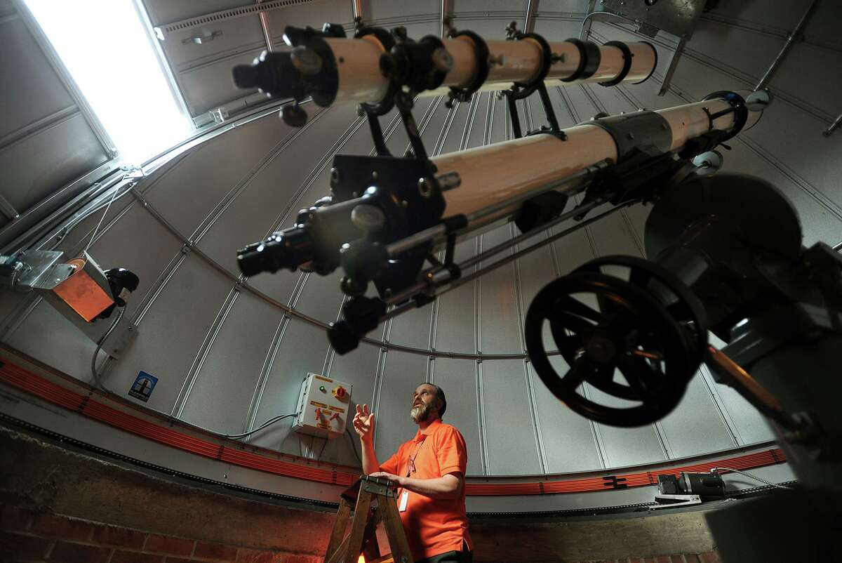 Bassick High School astronomy teacher Brian O'Shea demonstrates the operation of the new Ash 5 meter dome atop the school's observatory in Bridgeport, Conn. on Thursday, February 11, 2016.