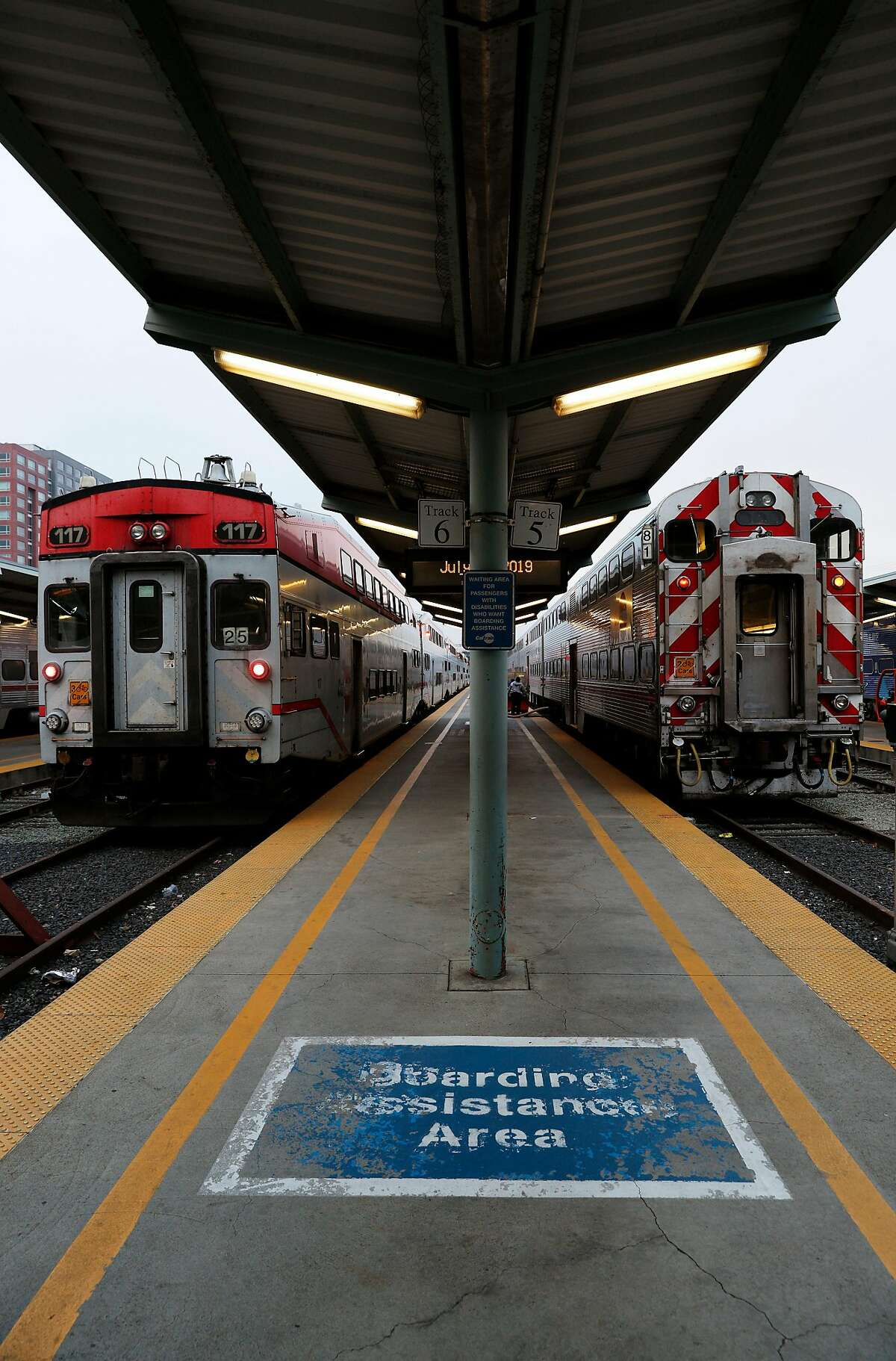 Two Caltrain trains sit at the Caltrain Station in San Francisco, Calif., on Thursday, July 18, 2019. Business leaders and transportation officials are putting together a sales tax ballot measure for next year that would generate billions for transportation infrastructure in the Bay Area. Top on their wish list is the downtown extension of Caltrain, with a tunnel running from the Mission Bay Area to the Transbay Terminal.