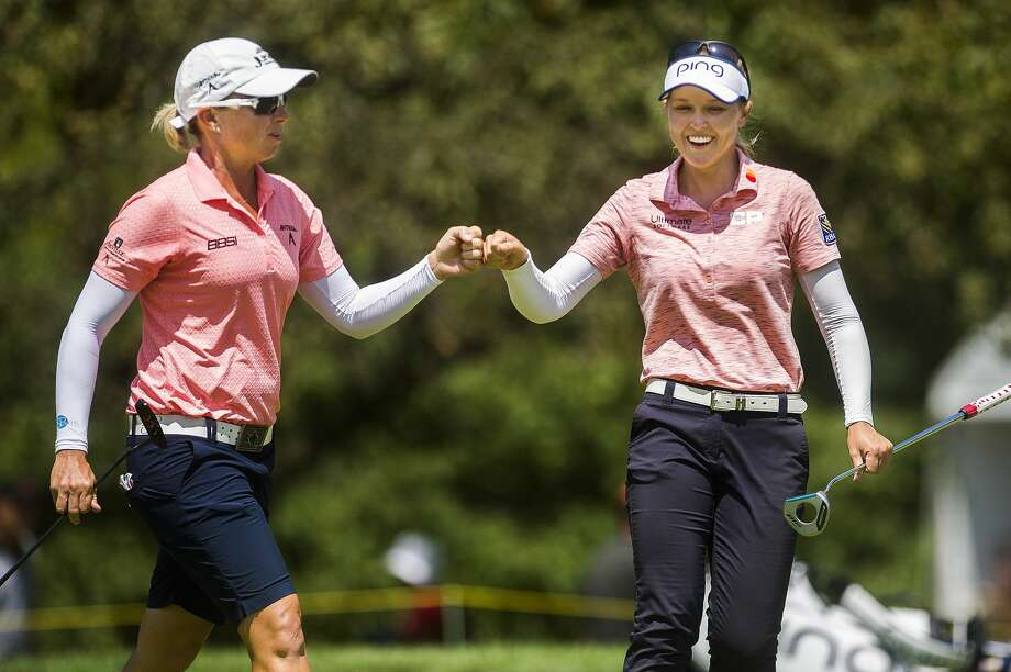 Brooke Henderson of Canada, right, fist bumps her playing partner, Alena Sharp of Canada, left, as they play in the third round of the Dow Great Lakes Bay Invitational on Friday, July 19, 2019 at Midland Country Club. (Katy Kildee/kkildee@mdn.net) Photo: (Katy Kildee/kkildee@mdn.net)