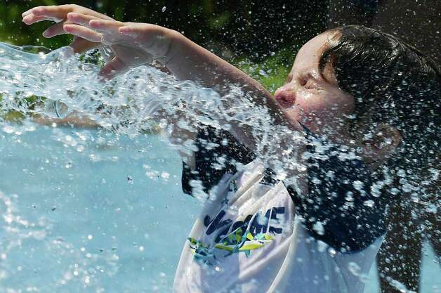 Leo Silbasadder, 3, of Norwalk, beats the heat by playing at the splash pad at Calf Pasture Beach in Norwalk.  Calf Pasture Beach's splash pad is located in between Calf Pasture Beach and Sandy Beach. Photo: Erik Trautmann / Hearst Connecticut Media / Norwalk Hour
