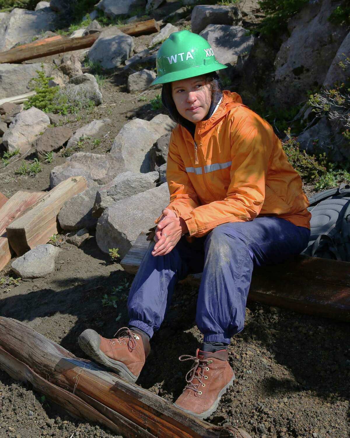 Xiomara Choto-Mueller, 16, takes a break as she and a crew of 14-18-year-old Latina girls works to build steps into the Wonderland Trail at Mt. Rainier, Thursday, July 18, 2019. They are a part of a Latino Conservation Week camp, hosted by Latino Outdoors and Washington Trails Association, which intends to expose Latinx youths to nature and outdoor careers and experiences.