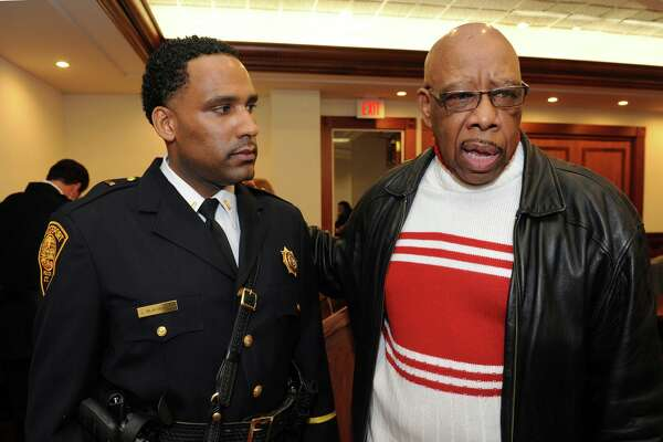 Bridgeport Police Lt. Lonnie Blackwell listens as retired officer Ted Meekins speaks at City Hall Annex in Bridgeport in 2010.