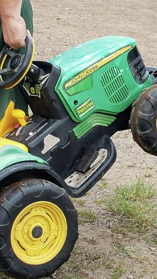 Toddler takes his toy tractor for a spin to county fair in Minnesota