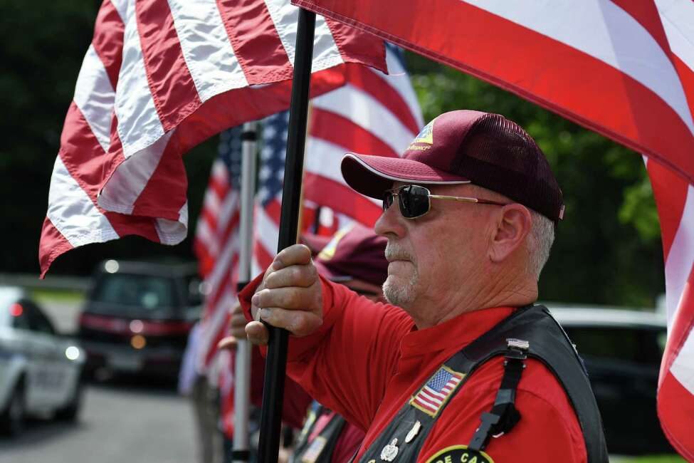 Patriot Guard Riders pay tribute to WWII veteran Charles Stern, whose remains were flown into Albany International Airport on Friday, July 19, 2019, in Colonie, N.Y. Stern died during the attack on Pearl Harbor in 1941. (Will Waldron/Times Union)