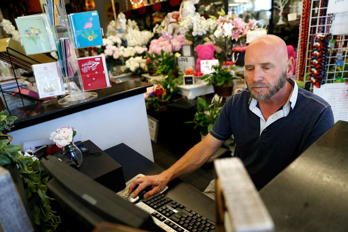 Fremont Flowers' Dirk Lorenz works on a computer at his store in Fremont, Calif., on Tuesday, July 16, 2019.