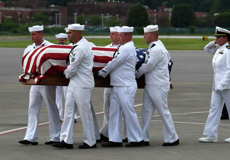 The remains of WWII veteran Charles Stern arrive at Albany International Airport on Friday, July 19, 2019, in Colonie, N.Y. Stern died during the attack on Pearl Harbor in 1941. (Will Waldron/Times Union) Photo: Will Waldron, Albany Times Union / 40047501A