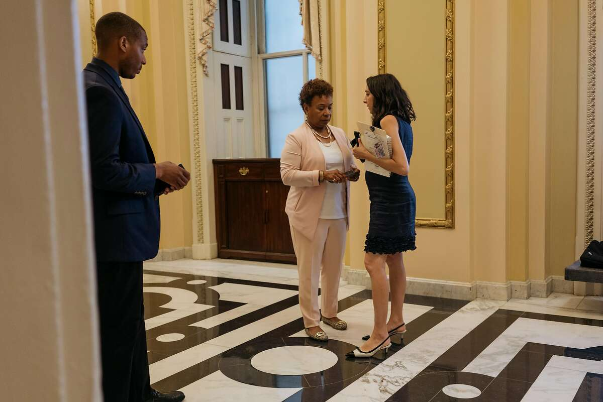 Rep. Barbara Lee talks to Diala Jadallah and David Stephen in the House halls Thursday, July 18, 2019, at the Capitol in Washington, D.C.