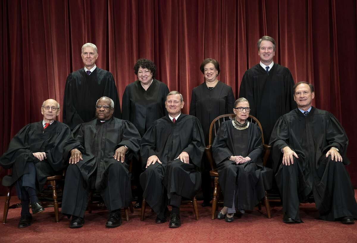 The justices of the U.S. Supreme Court gather for a formal group portrait to include the new Associate Justice, top row, far right, at the Supreme Court Building in Washington, Friday, Nov. 30, 2018. Seated from left: Associate Justice Stephen Breyer, Associate Justice Clarence Thomas, Chief Justice of the United States John G. Roberts, Associate Justice Ruth Bader Ginsburg and Associate Justice Samuel Alito Jr. Standing behind from left: Associate Justice Neil Gorsuch, Associate Justice Sonia Sotomayor, Associate Justice Elena Kagan and Associate Justice Brett M. Kavanaugh. (AP Photo/J. Scott Applewhite)