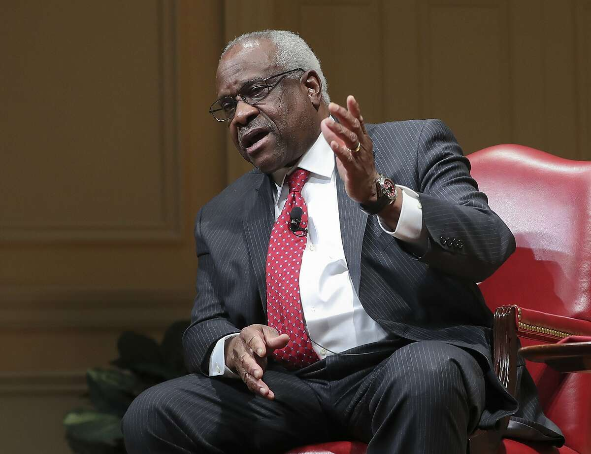 Supreme Court associate justice Clarence Thomas gestures as he speaks during an event at the Library of Congress Thursday, Feb. 15, 2018, in Washington. (AP Photo/Pablo Martinez Monsivais)
