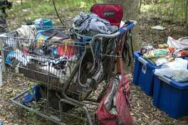 Belongings, food and water are scattered around a homeless camp Friday, July 19, 2019 after the camp relocated from a spot south of the Burlington Northern Sante Fe Railroad tracks near Old Magnolia Road.