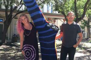 Billy Munoz, right, is working on a project to yarn bomb trees in Hemisfair. His first is outside Blue Cat Yoga and Healing Arts, which is owned by Trina Johansen, left.