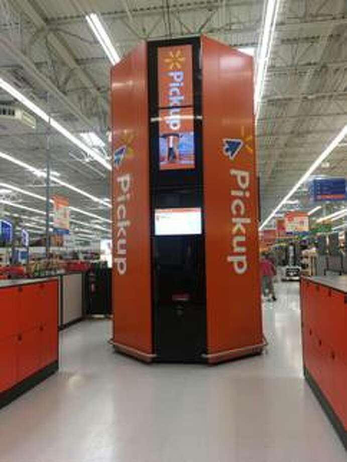 The Glenville Walmart store is the latest in the region to add a pickup tower, basically an oversize vending machine, that enables a customer to retrieve a previously ordered item in less than a minute after scanning a confirmation bar code sent to the purchaser's cellphone. Photo: Walmart