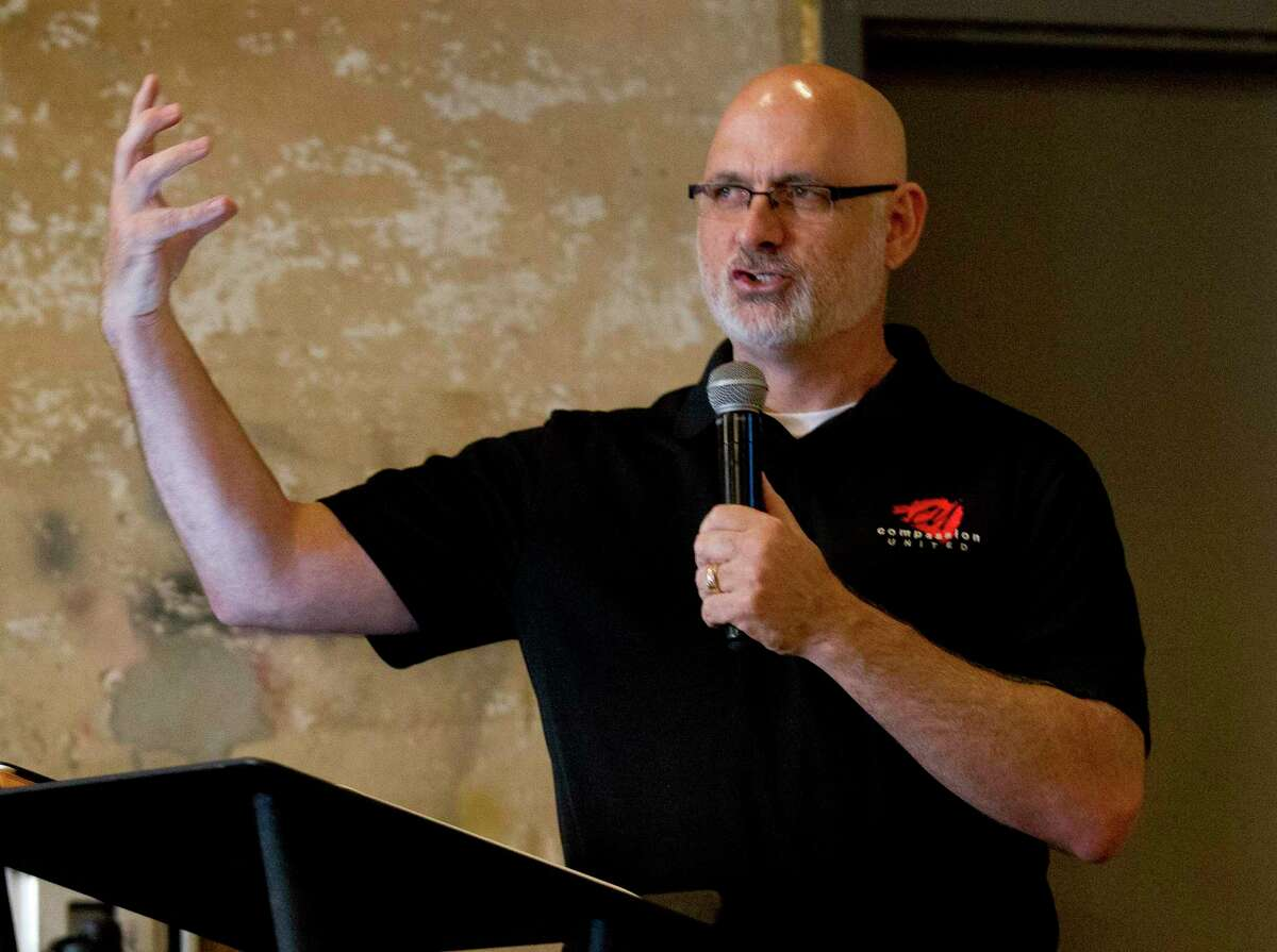 """Luke Redus, co-founder and director of Compassion United, preaches at Conroe House of Prayer, Wednesday, July 17, 2019, in Conroe. The ministry group is in the process of developing five acres of land off Foster Drive donated to them by the city of Conroe. In addition to moving CHOP from its location on West Davis Street to the donated land, the organization hopes to develop a master planned community called """"Miracle City"""" to support people transitioning out of homelessness and to provide long-term supportive housing options for those requiring financial, emotional, and community support for an extended period."""