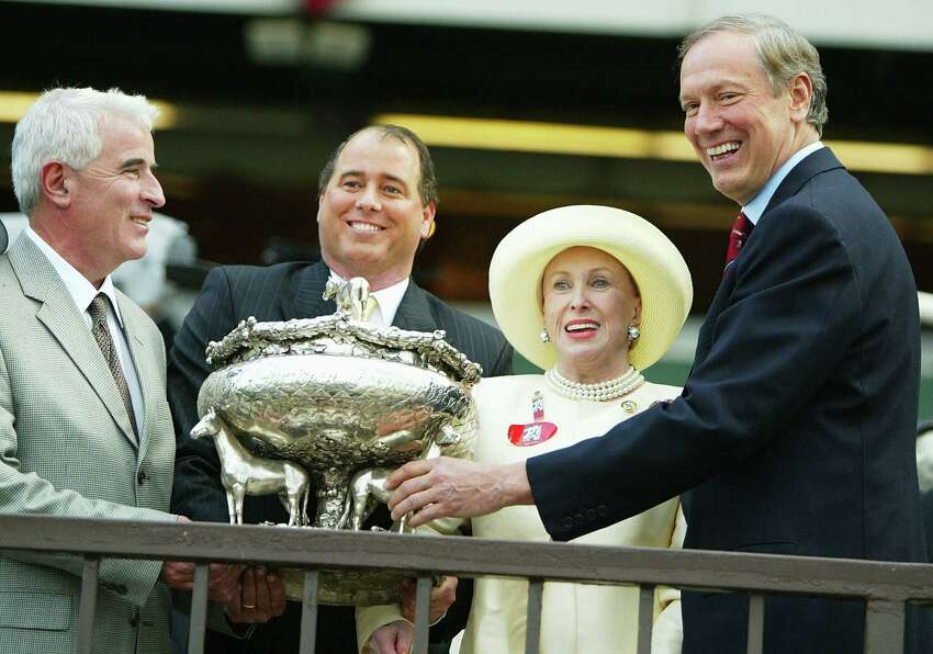 New York Governor George Pataki, right, gives the Belmont trophy to Birdstone's trainer Nicholas Zito, left, and owners John Hendrickson and Marylou Whitney after Birdstone won the 136th Belmont Stakes on June 5, 2004 at Belmont Park in Elmont, New York.