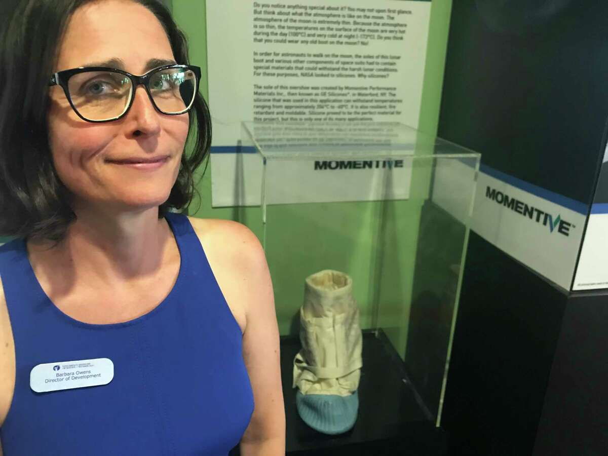 Barbara Owens, director of development at Children's Museum of Science and Technology with the prototype moon boot for the Apollo 11 moon mission that is on display at the museum at 250 Jordan Road in the Rensselaer Technology Park in North Greenbush. (Kenneth C. Crowe II/Times Union)