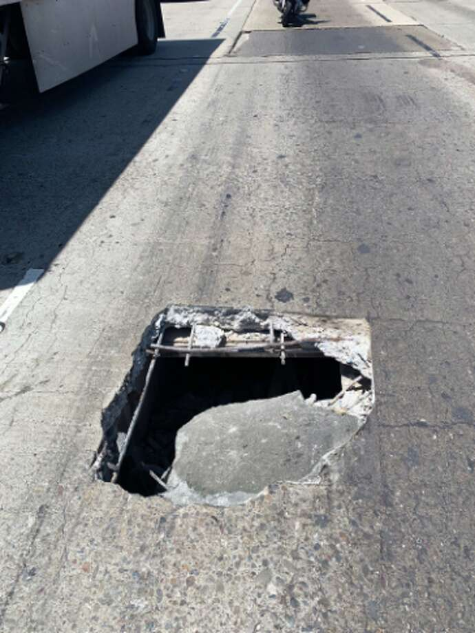 A large pothole closed a lane on southbound I-880 Friday afternoon. Photo: CHP Oakland/Twitter