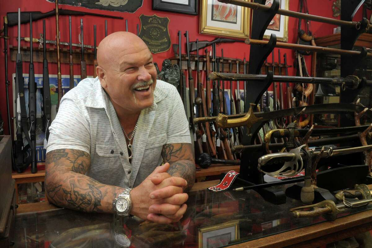 Tom Imperati, owner of The Hunter's Shop and a supporter of President Donald Trump, poses in his Branford store on Thursday.