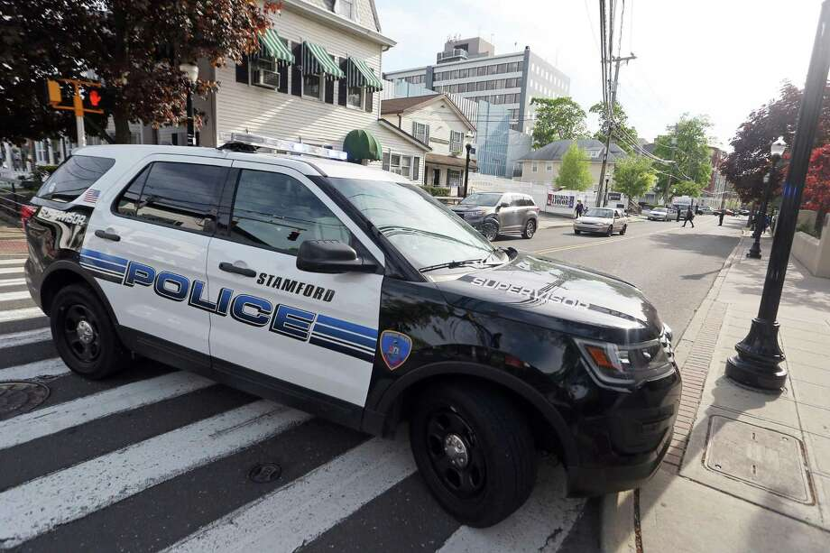 Stamford police blocked North St., from Washington Blvd. to Franklin St., while searching a car on Wednesday, May 11, 2016. Photo: Michael Cummo / Hearst Connecticut Media / Stamford Advocate
