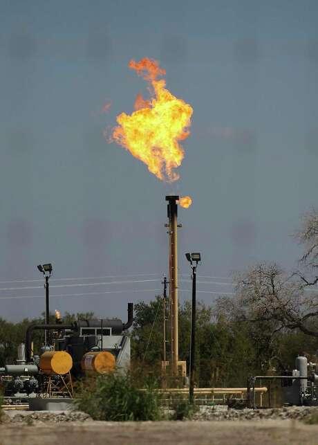 A flare burns near Helena, Texas in 2014. Kin Man Hui/San Antonio Express-News)