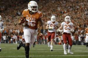 AUSTIN, TX - NOVEMBER 17:  Keaontay Ingram #26 of the Texas Longhorns runs into the end zone for a touchdown in the second quarter against the Iowa State Cyclones at Darrell K Royal-Texas Memorial Stadium on November 17, 2018 in Austin, Texas.  (Photo by Tim Warner/Getty Images)