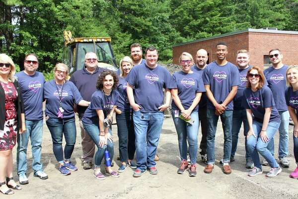 Volunteers from CAP COM Federal Credit Union helped groom Vanderheyden's low-challenge experiential-learning exercise area for its individuals outside the rising Career Center at the Wynantskill campus. (Photo submitted)