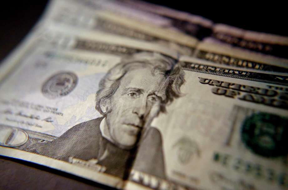 This June 13, 2018, shows United States currency in Zelienople, Pa. U.S. middle-class household incomes rose for the third straight year in 2017, as more Americans are working and the number of people with full-time jobs increased. (AP Photo/Keith Srakocic) Photo: Keith Srakocic / Keith Srakocic/Associated Press / Copyright 2018 The Associated Press. All rights reserved.
