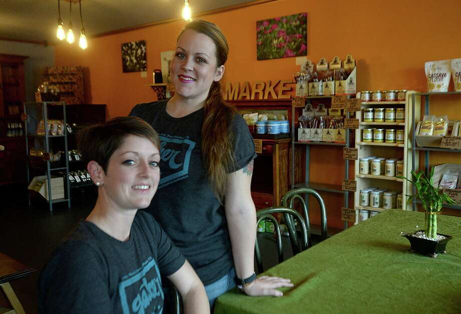 Gather Paleo Market opened mid-January on Magnolia Avenue in Port Neches. In addition to offering grains, spices, and other non-GMO food items in its market, the establishment offers a daily menu special that adheres to the paleo diet and is made from farm-to-table ingredients. Co-owners Chrystal Lundy (seated) and Jodi Hebert have been following a pale diet for years and finally realized their dream of opening their own market/cafe.  Photo taken Wednesday, January 27, 2016  Kim Brent/The Enterprise Photo: Kim Brent / Kim Brent/The Enterprise / Beaumont Enterprise