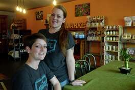 Gather Paleo Market opened mid-January on Magnolia Avenue in Port Neches. In addition to offering grains, spices, and other non-GMO food items in its market, the establishment offers a daily menu special that adheres to the paleo diet and is made from farm-to-table ingredients. Co-owners Chrystal Lundy (seated) and Jodi Hebert have been following a pale diet for years and finally realized their dream of opening their own market/cafe. Photo taken Wednesday, January 27, 2016 Kim Brent/The Enterprise
