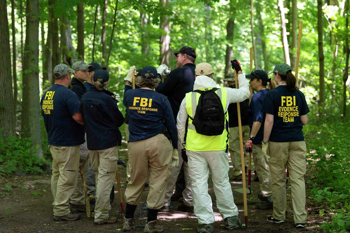 An FBI Evidence Response Team combs a heavily wooded area in Waveny Park in New Canaan on Monday afternoon, June 3, 2019.