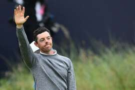 Northern Ireland's Rory McIlroy waves as he leaves the 18th green during the second round of the British Open golf Championships at Royal Portrush golf club in Northern Ireland on July 19, 2019. (Photo by Glyn KIRK / AFP) / RESTRICTED TO EDITORIAL USEGLYN KIRK/AFP/Getty Images