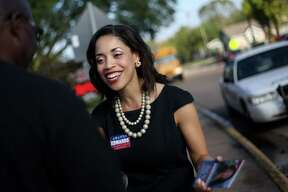 Amanda Edwards talks to voters in front of a polling station located in Windsor Village Elementary School on Tuesday, Nov. 3, 2015, in Houston. She was elected to the Houston City Council that year and is now seeking the Democratic nomination to run against Republican U.S. Sen. John Cornyn.