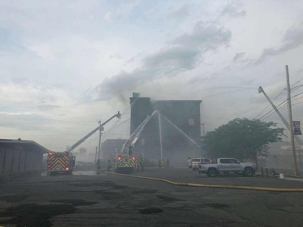 Fire crews battle a blaze at 701 River St. in Troy, N.Y., on July 19, 2019.