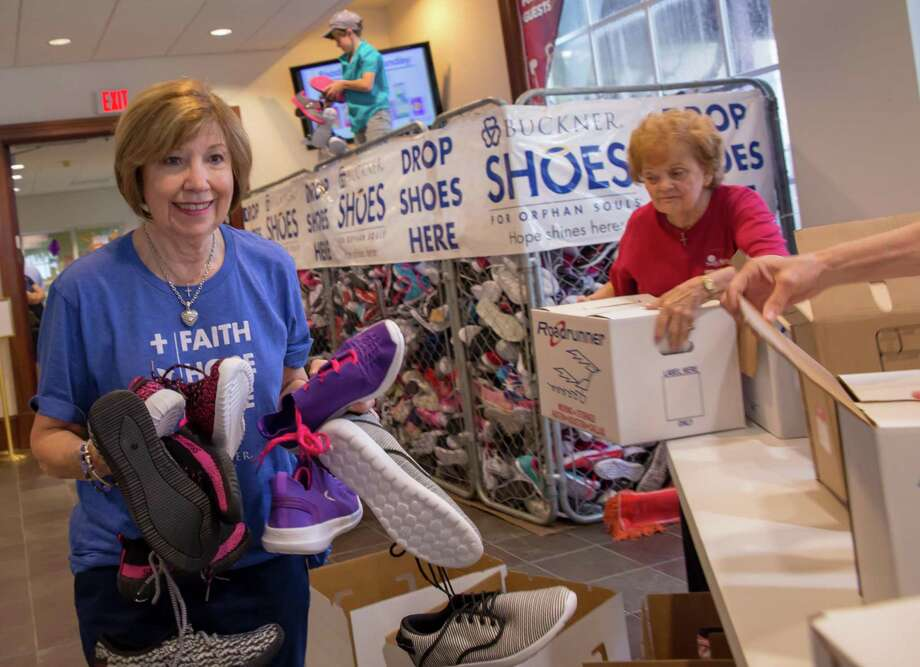Members at South Main Baptist Church sort through shoes on Sept. 2, 2018, for the annual Henry Hill Memorial Shoe Drive benefiting Buckner Shoes for Orphan Souls. Each year, the church collects around 10,000 shoes to go to children in need across the United States and world. Photo: Courtesy Photo