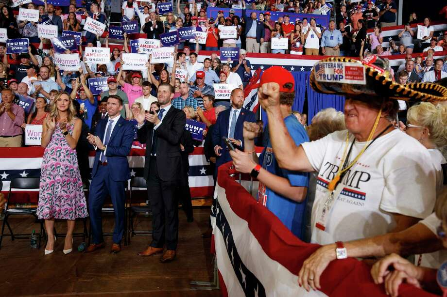 Eric Trump, the son of President Donald Trump, and his wife Lara Trump and her brother Kyle Yunaska, applaud during a campaign rally at Williams Arena in Greenville, N.C., Wednesday, July 17, 2019. (AP Photo/Carolyn Kaster) Photo: Carolyn Kaster, STF / Associated Press / Copyright 2019 The Associated Press. All rights reserved