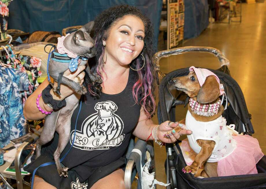 People pose for a photograph with their dogs at the Houston World Series of Dog Show at NRG Center on Friday, July 19, 2019, in Houston. Photo: Yi-Chin Lee, Staff Photographer / © 2019 Houston Chronicle