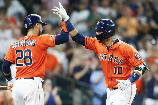 Houston Astros first baseman Yuli Gurriel (10) is congratulated after hitting a solo home run by catcher Robinson Chirinos (28) against the Texas Rangers at Minute Maid Park on Friday, July 19, 2019 in Houston.