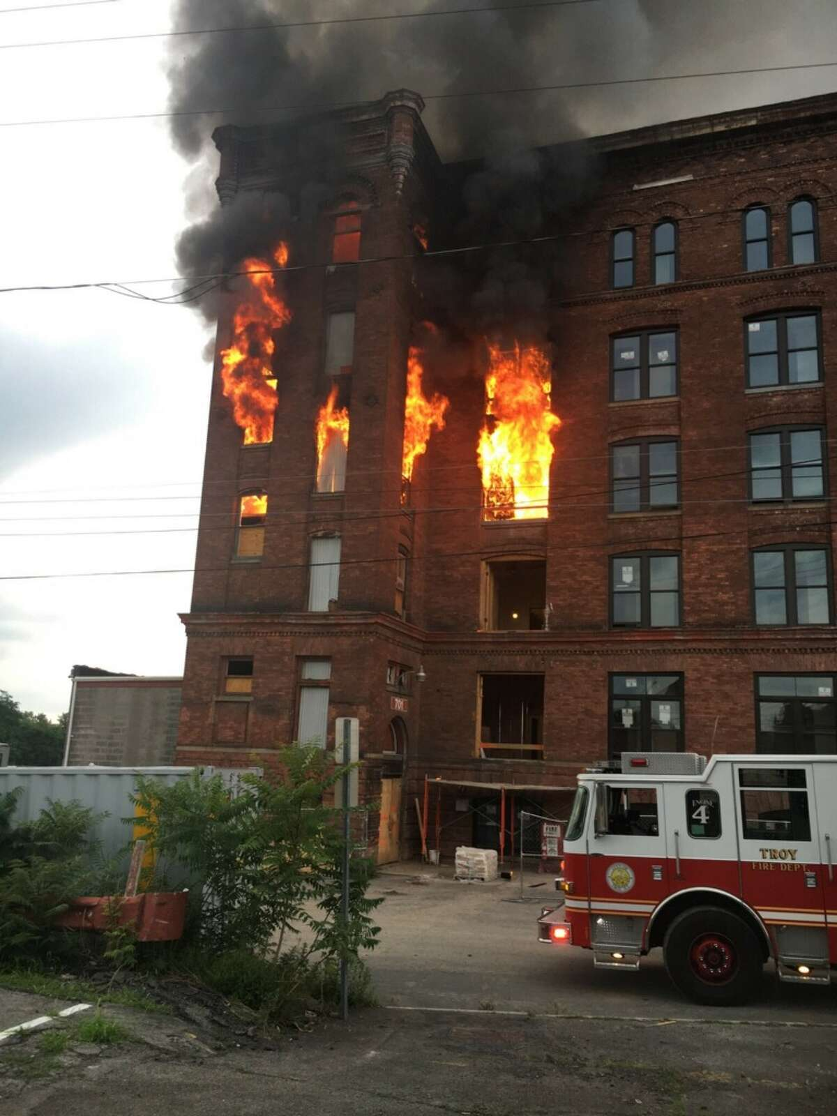 Fire crews battle a blaze at 701 River St. in Troy, N.Y., on July 19, 2019.