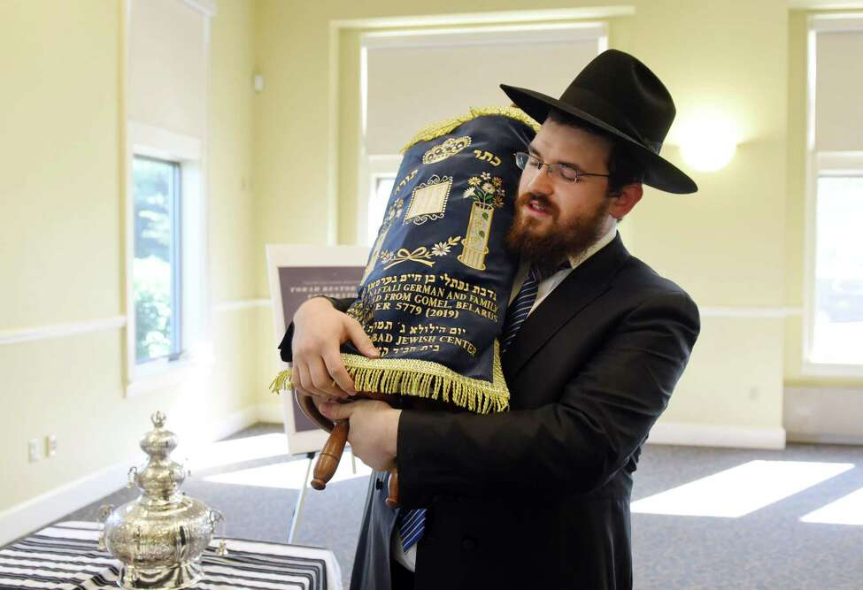 Rabbi Mordechai Rubin talks about a 100-year-old Torah on Wednesday, June 26, 2019 at the Crossings Park in Albany, NY. (Phoebe Sheehan/Times Union)