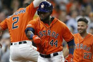 Houston Astros designated hitter Yordan Alvarez (44) celebrates his solo home run with hitters Alex Bregman (2) and Jose Altuve (27) in the third inning against  the Texas Rangers at Minute Maid Park on Friday, July 19, 2019 in Houston.