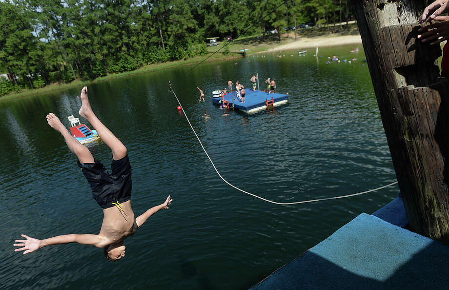 Families and children enjoy cooling off and getting in some high-dive fun at Smith Lake Waterpark in Vidor Friday. Photo taken Friday, July 19, 2019 Kim Brent/The Enterprise Photo: Kim Brent