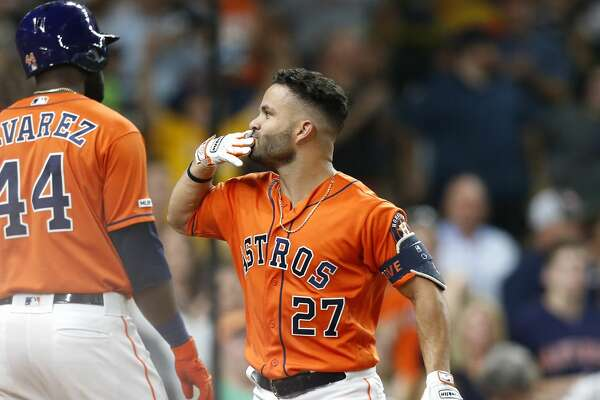 Houston Astros second baseman Jose Altuve (27) blows a kiss after hitting a solo home run in the bottom of the third inning against the Texas Rangers at Minute Maid Park on Friday, July 19, 2019 in Houston.