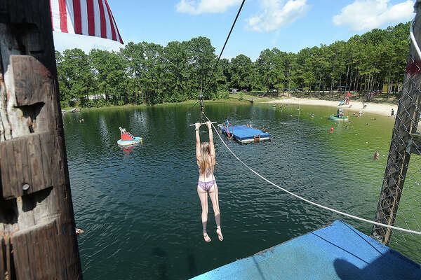 Families and children enjoy cooling off and getting in some high-dive fun at Smith Lake Waterpark in Vidor Friday. Photo taken Friday, July 19, 2019 Kim Brent/The Enterprise