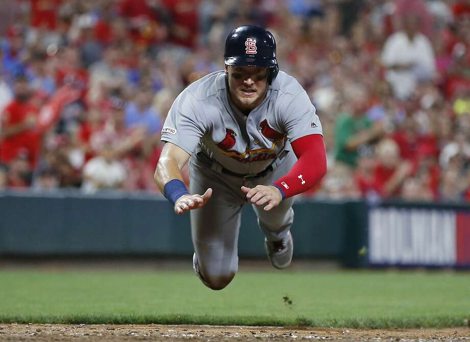 Andrew Knizner slides head first to score during the sixth inning for the Cardinals on Friday night. Photo: Gary Landers / Associated Press