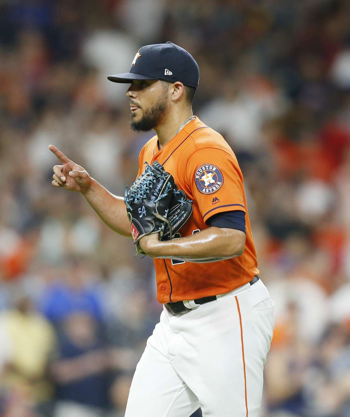 Houston Astros relief pitcher Roberto Osuna (54) celebrates the teams 4-3 win over theTexas Rangers at Minute Maid Park on Friday, July 19, 2019 in Houston.