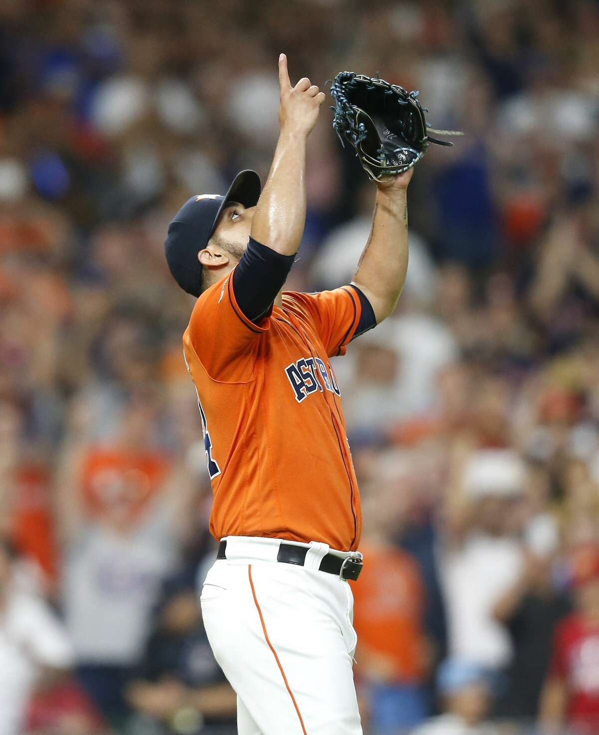 Houston Astros relief pitcher Roberto Osuna (54) reacts to the final out in the ninth inning for the Texas Rangers at Minute Maid Park on Friday, July 19, 2019 in Houston. Houston Astros won the game 4-3.