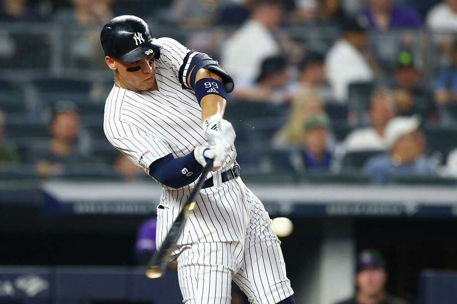 NEW YORK, NEW YORK - JULY 19:  Aaron Judge #99 of the New York Yankees hits a two-run home run to right field in the sixth inning against the Colorado Rockies at Yankee Stadium on July 19, 2019 in New York City. (Photo by Mike Stobe/Getty Images) Photo: Mike Stobe / 2019 Getty Images