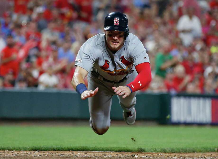 St. Louis Cardinals' Andrew Knizner, left, slides head first to score during the sixth inning of the team's baseball game against the Cincinnati Reds on Friday, July 19, 2019, in Cincinnati. (AP Photo/Gary Landers) Photo: Gary Landers / Copyright 2019 The Associated Press. All rights reserved.