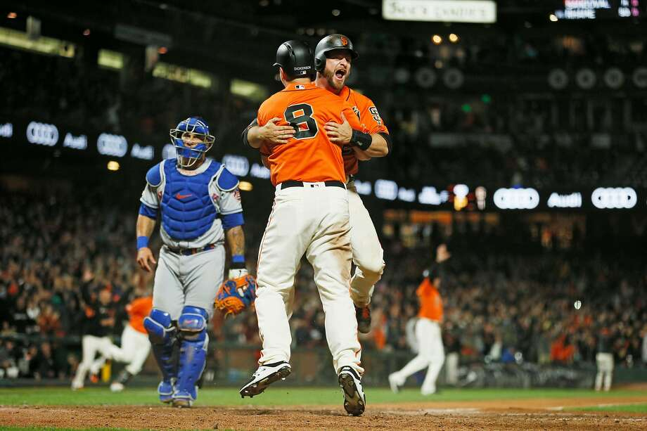 San Francisco Giants catcher Stephen Vogt (21) celebrates after sliding home to score in the 10th inning of an MLB game against the New York Mets at Oracle Park, Friday, July 19, 2019, in San Francisco, Calif.San Francisco Giants left fielder Alex Dickerson (8) celebrates with Vogt. Photo: Santiago Mejia / The Chronicle